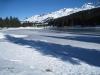 Tannen gespiegelt auf dem Eis des Heidsee; Gürgaletsch 2441m, langer Grat,  Parpaner Schwarzhorn 2683m, Parpaner Weisshorn 2824m
