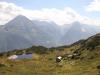 Sicht auf Bergsee und Sunniggrätli Hütte; Bristen und Rienzenstock